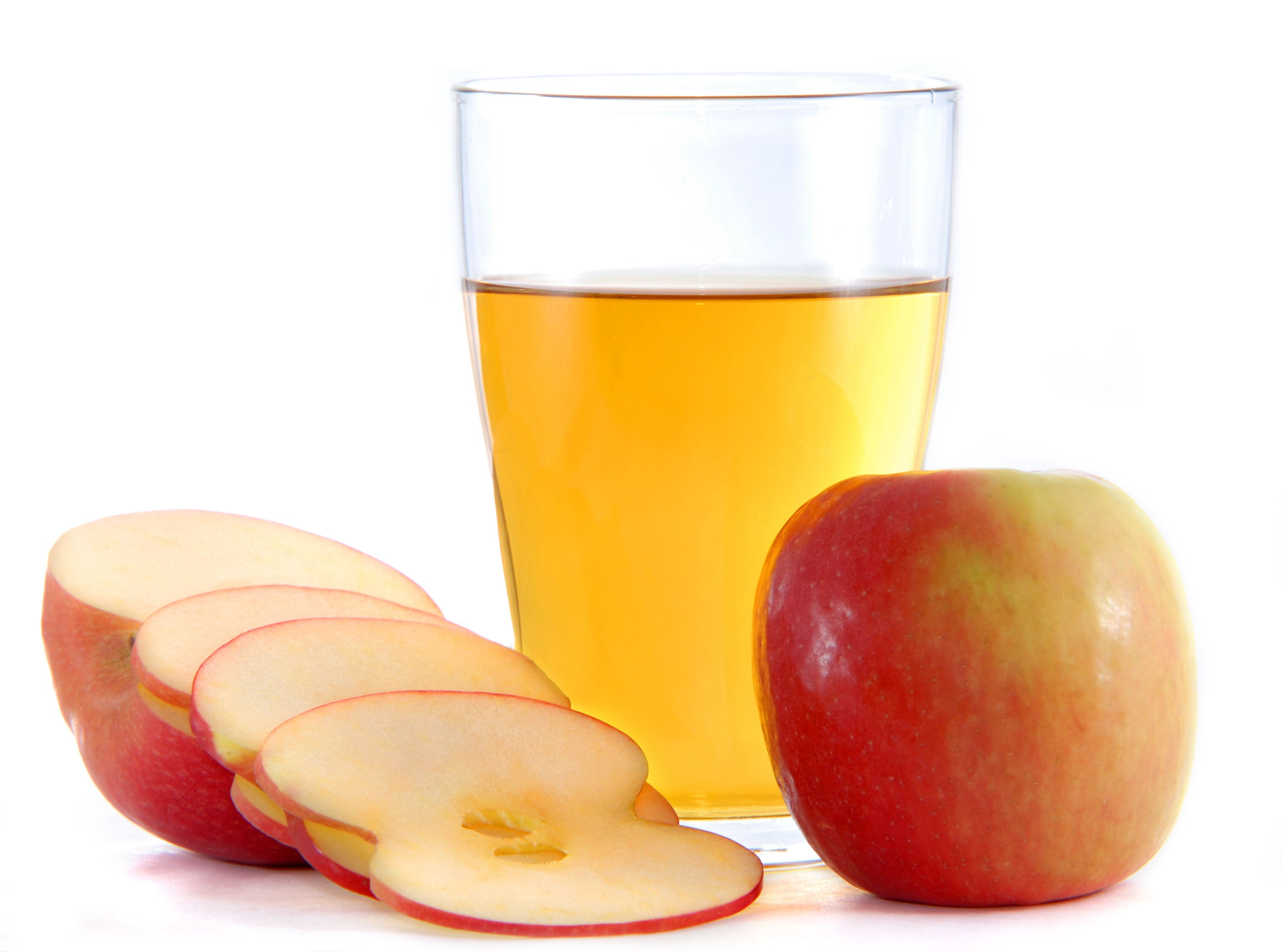 acv in glass with apples